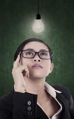 Business-woman-having-bright-lit-idea