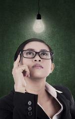 Business-woman-having-bright-lit-idea