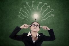 Business-woman-with-bright-light-and-mind-map